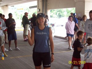 Person holding a bottle and wearing a HydroWorx Shirt