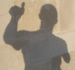 Shadow of person giving thumbs up sign