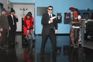 Person in suit dancing with others in the background