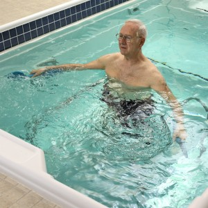 Person using HydroWorx therapy pool