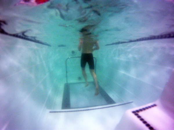 Underwater camera shot of person using HydroWorx treadmill