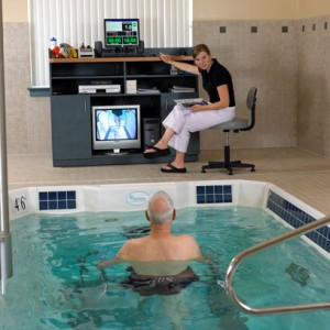 Person participating in underwater therapy with instructor
