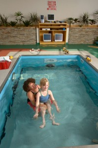 Adult and Child doing hydro therapy