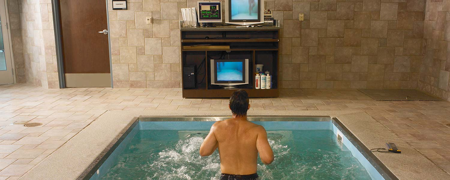 Person watching underwater camera of their hydrotherapy