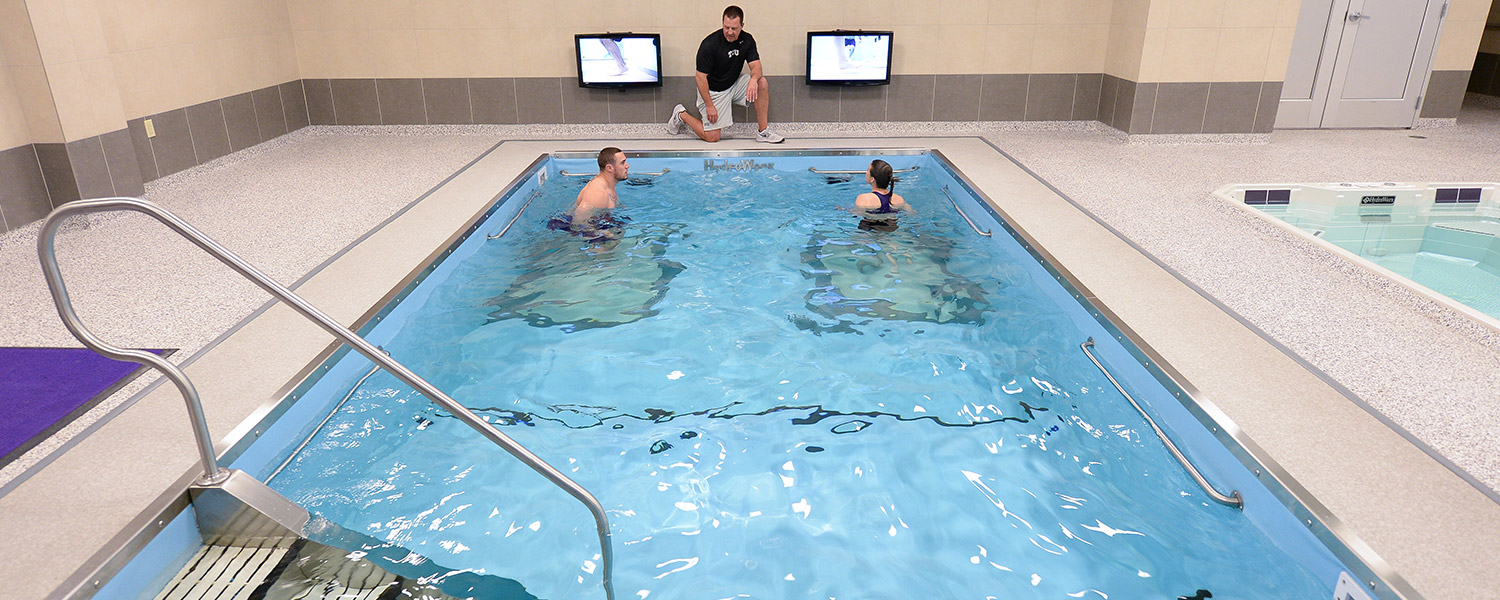 Two People training in therapy pool