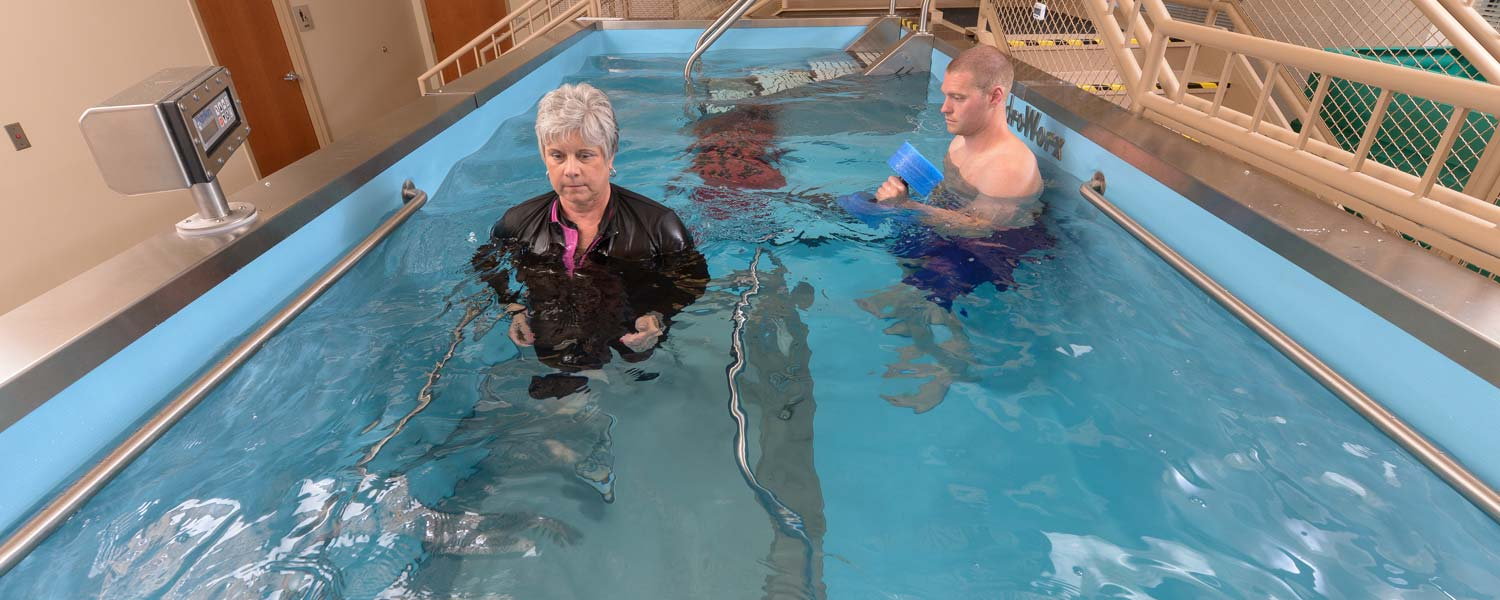 Two people training in a HydroWorx pool