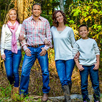 Family wearing jeans posing for photo