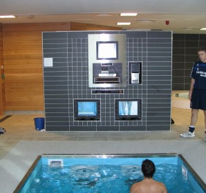 Trainer and Trainee using HydroWorx pool equipment