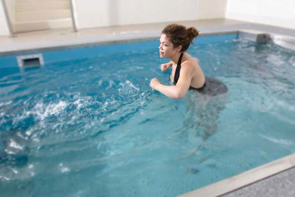 Person stretching in HydroWorx Pool