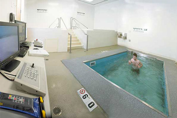 Person running against current in therapy pool