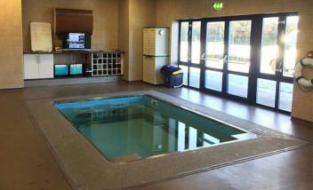 Indoor HydroWorx pool by building exit