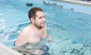 Person smiling and running in HydroWorx Pool