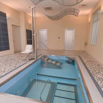 Floor to ceiling view of indoor HydroWorx pool area