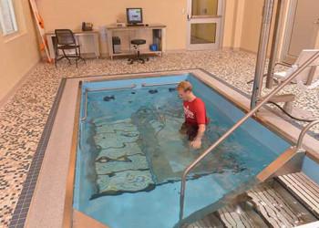 Person training on pool treadmill
