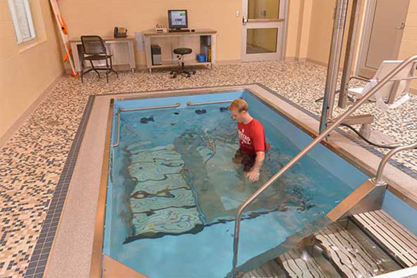 Person training on pool treadmill