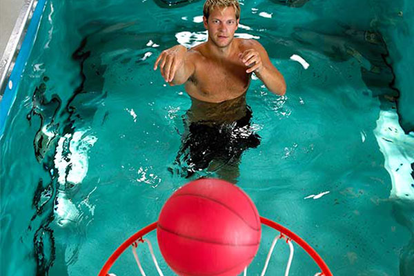 Person shooting basketball from HydroWorx pool