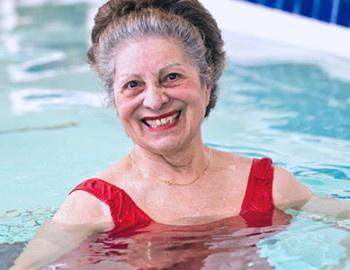 Elder smiling in HydroWorx pool