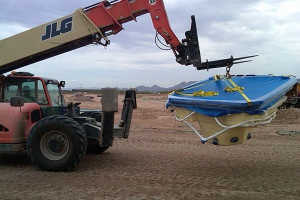 Forklift carrying pool equipment
