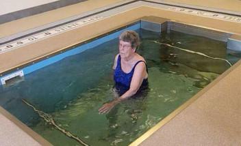 Elder walking in HydroWorx pool