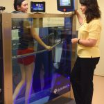 woman talking to trainer while in hydroworx 350