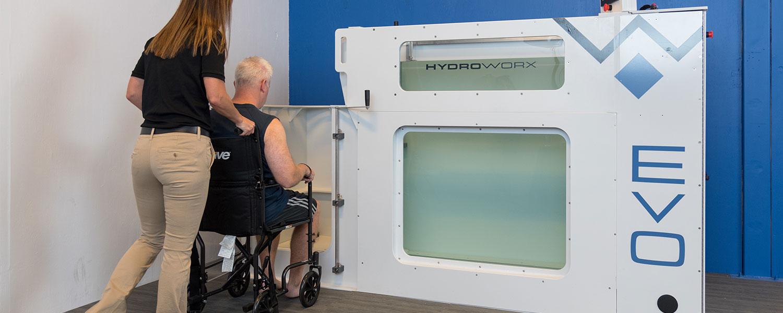 man in wheelchair using handicap entrance to evo