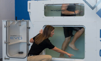 trainer working with athlete in hydroworx evo