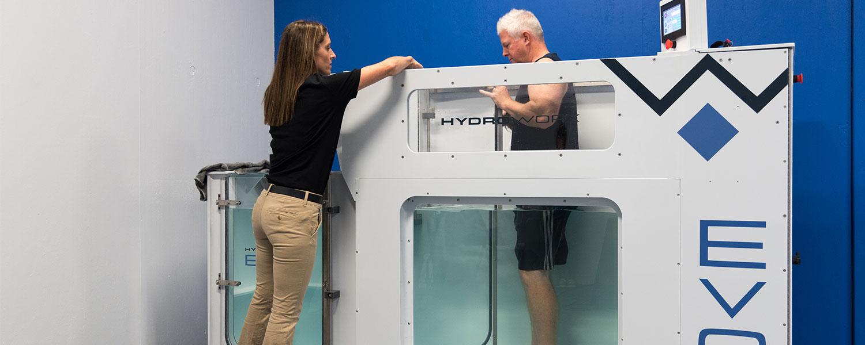 man training in hydroworx evo with trainer